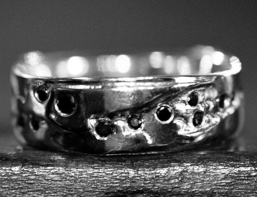 Platinum wedding band, multiple black diamonds